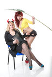 Two girls. Slave girl and devil boss Stock Photo