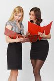 Two girls. Two cute female students reading the documents Royalty Free Stock Photo