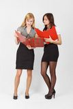Two girls. Two cute female students reading the documents Royalty Free Stock Images