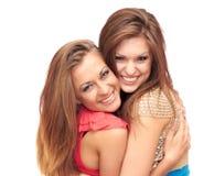 Two girls. Two happy girls hug on white background Stock Photo