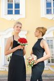 Two girls. With bouquets of roses Royalty Free Stock Photo
