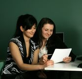 Two girls. At the computer Royalty Free Stock Images