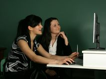 Two girls. At the computer Stock Photo