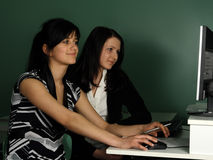 Two girls. At the computer Royalty Free Stock Photography