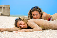 Two girls. Young girls, sunbathing by the sea Stock Photo