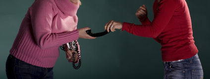 Two girls abduct for phone Royalty Free Stock Photo