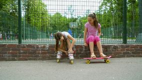 Two girls active passtime in park royalty free stock photo