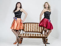 Two Girls actress singer in cocktail dresses  blonde and brown hair Royalty Free Stock Photography