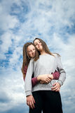 Two girls against the sky. Two beautiful young girls were photographed against the sky Royalty Free Stock Image