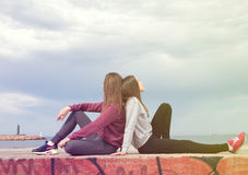 Two girls against the sky. Two beautiful young girls were photographed against the sky Stock Photography