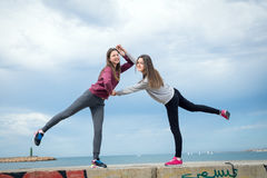 Two girls against the sky. Two beautiful young girls were photographed against the sky Stock Photos