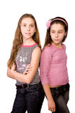 Two girls in the age of ten and eleven standing Royalty Free Stock Image