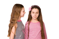 Two girls in the age of ten and eleven talking Royalty Free Stock Photography