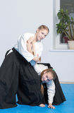 Two girls on Aikido training on white background Stock Images