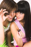 Two Girls And Chocolate Stock Photos