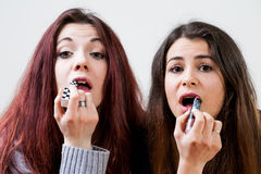 Two girls applying make up together Royalty Free Stock Photos