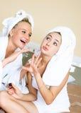 Two girls applying nail polish Stock Image