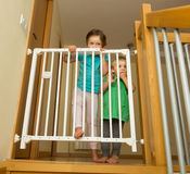 Two girls approaching safety gate stock photography