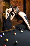 Two Girls At Pool Table Royalty Free Stock Image