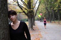 Two girls at autumn park Stock Photos