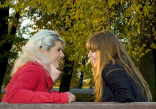 Two girls in autumn park Royalty Free Stock Photo