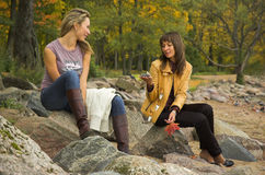 Two girls in autumn park Stock Images