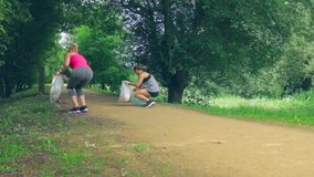 Two girls on back doing plogging stock video footage