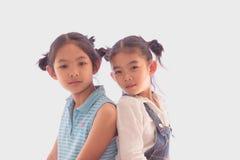 Two girls back together. Two girls back together on whaite background Stock Image