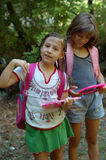 Two girls with backpacks. Two girls wearing backpacks holding small chalkboards ready for school Stock Image