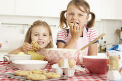 Two Girls Baking In Kitchen Stock Images