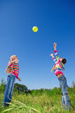 Two girls with ball. Two girls catching and throwing ball Royalty Free Stock Photography