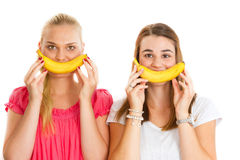 Two girls with banana smile Royalty Free Stock Photos