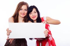 Two girls with banner. Royalty Free Stock Images