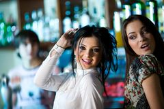 Two girls in bar Stock Images