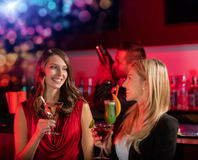 Two girls at the bar with cocktail drink Royalty Free Stock Image