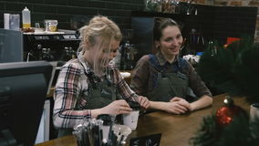 Two girls at the bar. Served coffee. Slow motion. Two cheerful girls at the bar. Served coffee. Slow motion stock footage