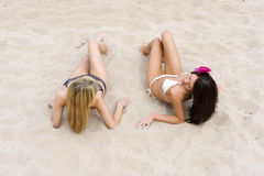 Two girls on beach Stock Images
