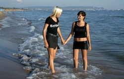 Two girls on a beach Royalty Free Stock Images