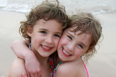 Two Girls at Beach. Two young girls hug each other while at the beach Royalty Free Stock Photography