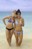 Two girls at the beach. Two girls in bikinis at the beach Stock Images