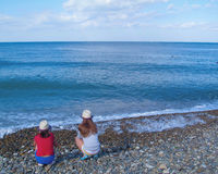 Two girls. On the beach, the Black Sea, Divnomorskoe Royalty Free Stock Photos