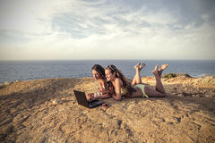 Two girls at the beach chatting Royalty Free Stock Images
