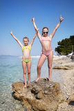 Two girls on beach of sea Stock Images