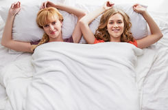 Two girls at bed Royalty Free Stock Photos