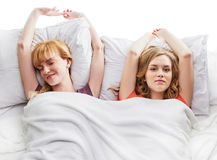 Two girls at bed Royalty Free Stock Image