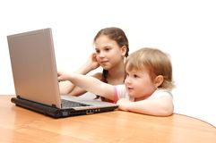 Two girls behind the laptop Stock Photo