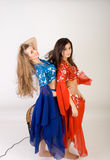 Two girls belly dancing Stock Images