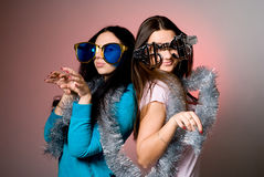 Two girls in the big fancy glasses Stock Image