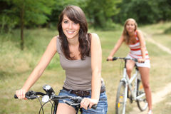 Two girls on bikes Royalty Free Stock Photo