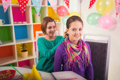 Two girls on birthday party Stock Photos